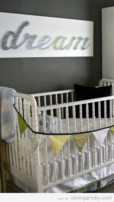 "Wall String Art with the word ""Dream"" to decorate a baby bedroom"