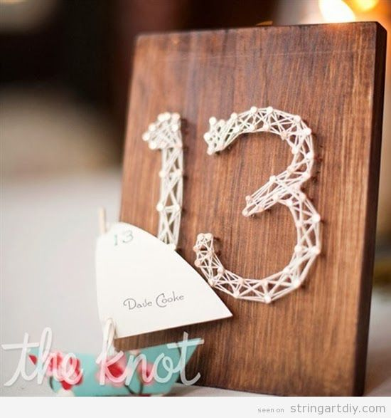 Table numbers on a wedding made with String Art