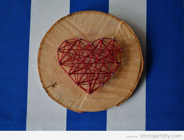 Heart String Art on a tree slice, step 1Heart String Art on a tree slice, step 3