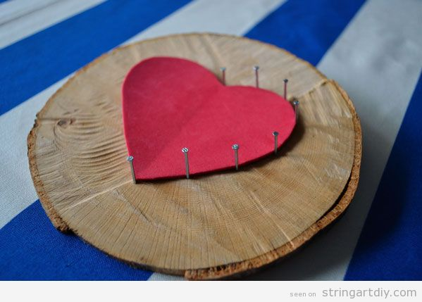 Heart String Art on a tree slice, step 2