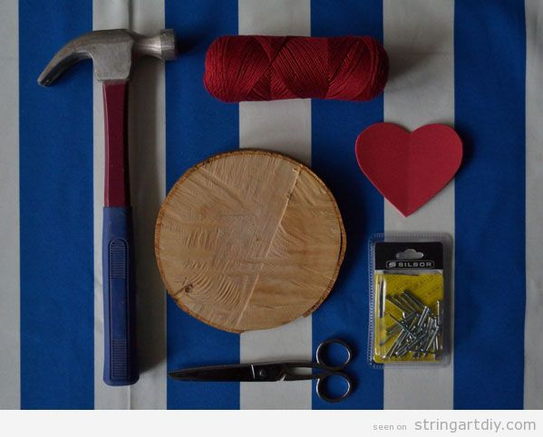 Heart String Art on a tree slice, step 1