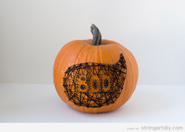 Boo ghost string art on a pumpkin 1