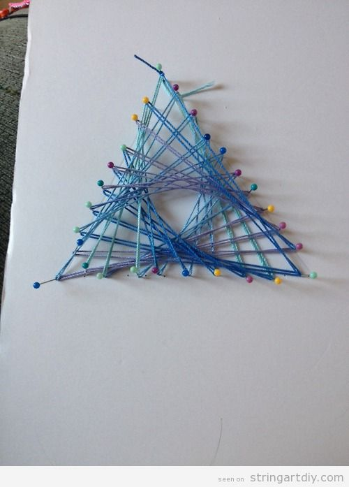 Easy String Art with pins and threads on paper