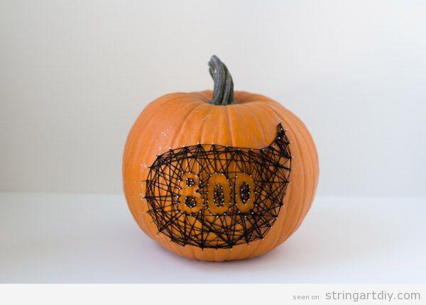 Boo ghost string art on a pumpkin 1
