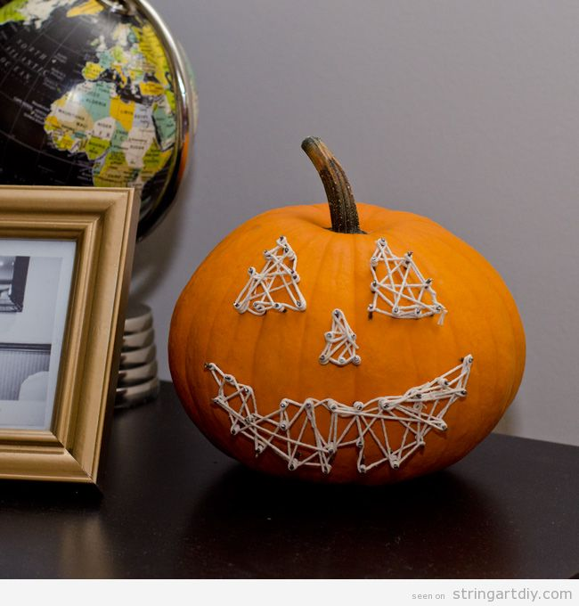 Evil face String Art on a ¡ pumpkin