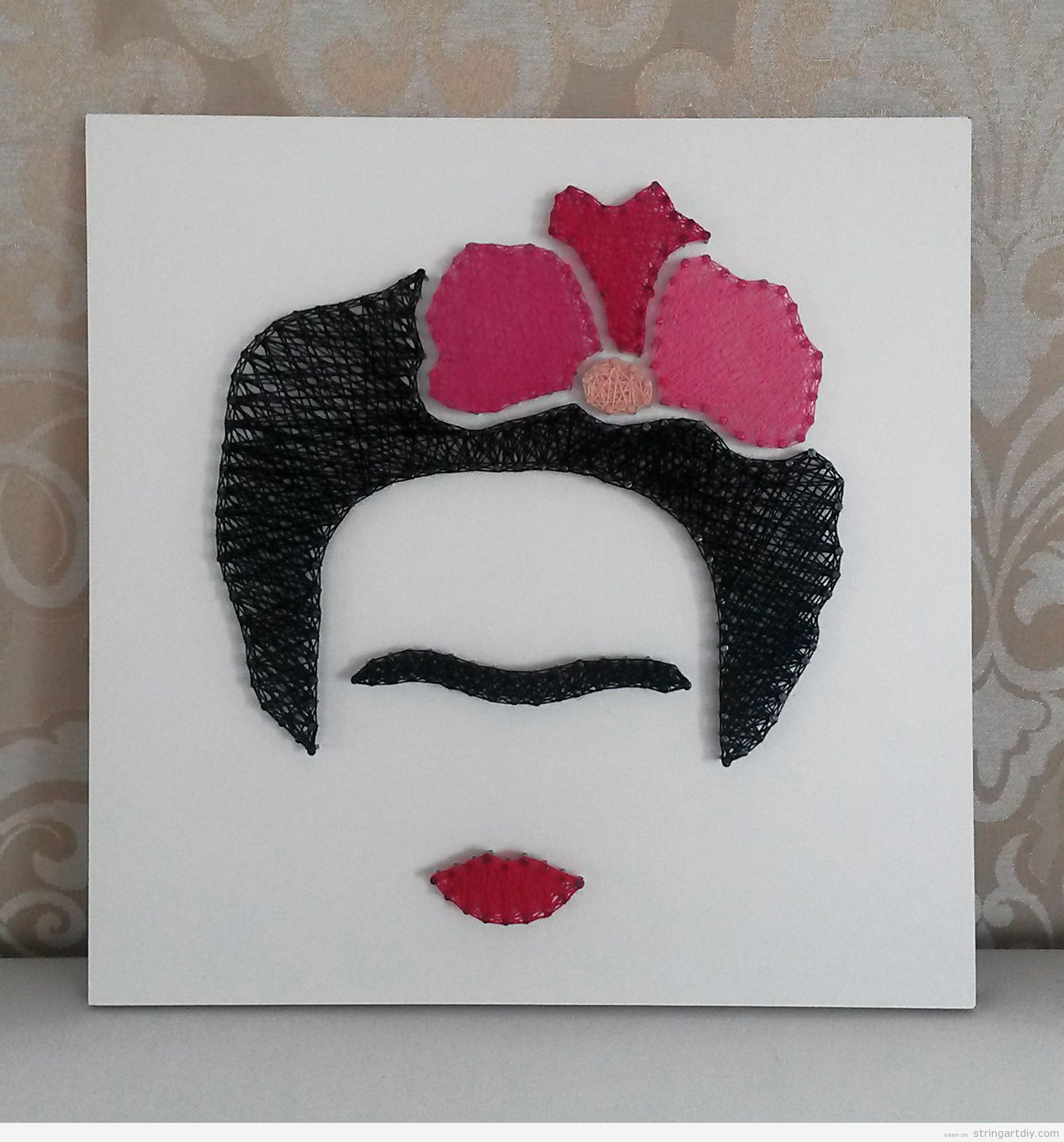 In this one we have less distinctive traits but we are able to recognize her hair updo with flowers eyebrows joined and red lips